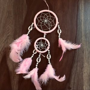 Pink boho feather and shell dream catcher